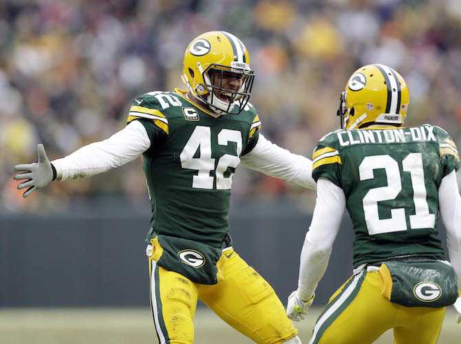 Jan 11, 2015; Green Bay, WI, USA; Green Bay Packers strong safety Morgan Burnett (42) and free safety Ha Ha Clinton-Dix (21) react after a play call was overturned in the 2014 NFC Divisional playoff football game against the Dallas Cowboys at Lambeau Field. Mandatory Credit: Jeff Hanisch-USA TODAY Sports