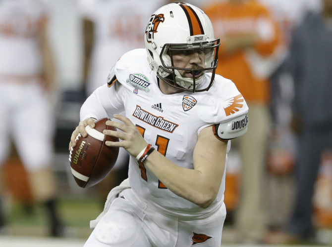 Bowling Green quarterback Matt Johnson scrambles during the first quarter of an NCAA college football game against Northern Illinois at the Mid-American Conference championship at Ford Field in Detroit, Friday, Dec. 6, 2013. (AP Photo/Carlos Osorio)