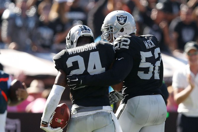 charles-woodson-khalil-mack-raiders_130316