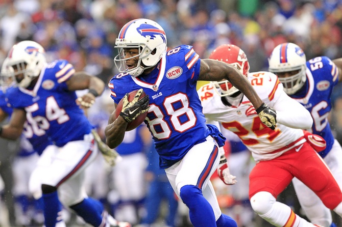 FILE - In this Nov. 9, 2014, file photo, Buffalo Bills wide receiver Marquise Goodwin (88) runs with the ball against the Kansas City Chiefs during the first half of an NFL football game, in Orchard Park, N.Y. Goodwin fully plans to skip part of training camp this summer. Not because of a dispute over playing time or anything like that. The kick returner/receiver doubles as a premier long jumper and hopes to make the American squad for the Rio Olympics.(AP Photo/Bill Wippert, File)